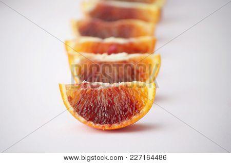 Pieces Of Tasty Juicy Blood Orange On White Background. Horisontal. Healthy, Seasonal Concept.