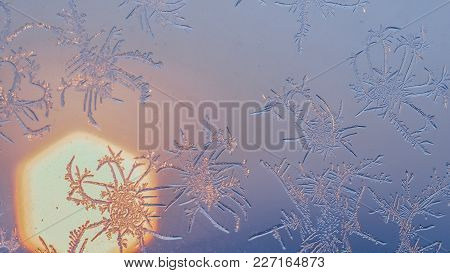 Snowflakes On The Window In Supermacro Shooting. They Are Highlighted By The Sunset. Real Real Snowf