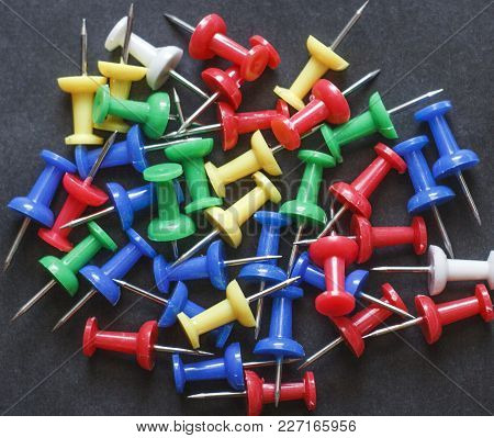 Multicolored Stationery Paper Clips On A Black Background