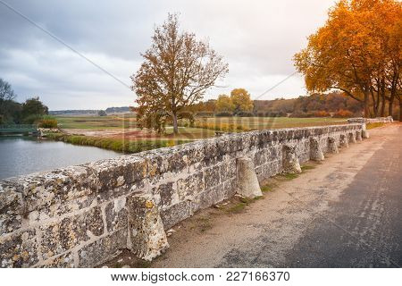 French Park Landscape, Road On Old Stone Bridge And Autumn Trees