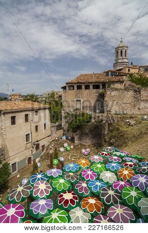 Girona-spain-may 12,2012: Decorated Umbrellas In Historic Center Of Catalan City Of Girona. In Sprin