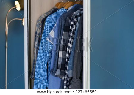 Closet with different shirts, closeup. Fashionable wardrobe