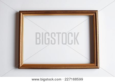 Brown Golden Color Horizontal Frame For Picture Or Photo On Light Background. Top View.