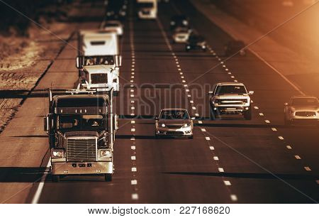 California Highway Traffic. Four Lanes One Direction Highway. Trucks And Cars On The Way. American T