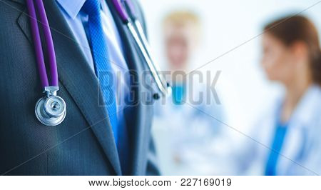 Portrait of a  male doctor standing in the hospital
