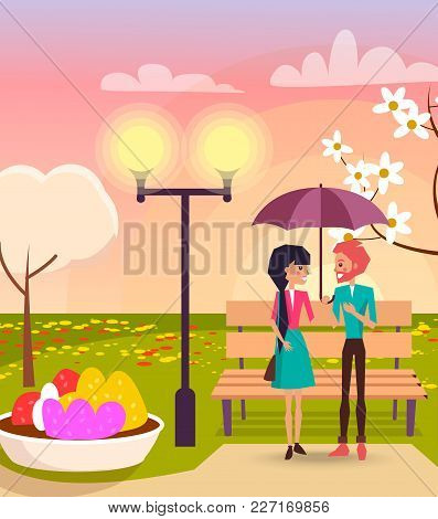 Happy Couple In Love Under Purple Umbrella Near Wooden Branch, Bright Streetlight And Flower Bed In