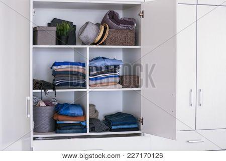 Closet with stylish clothes. Fashionable wardrobe