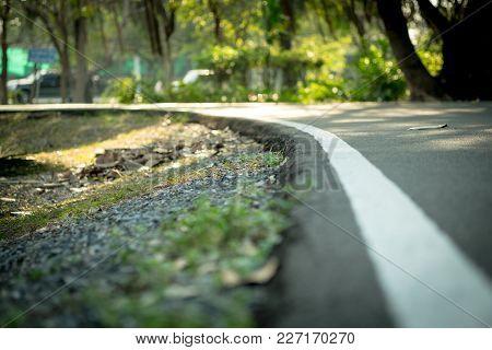 Curve Way Running And Walkway Aphalt Floor In Public Park, Shot With Low Depth Of Field, Selective F