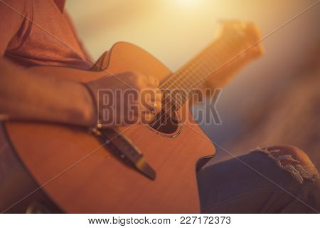 Caucasian Musician With Classic Acoustic Guitar. Guitar Ballad Playing