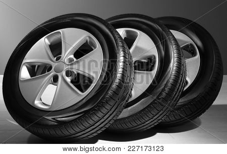 Car tires with rims indoors