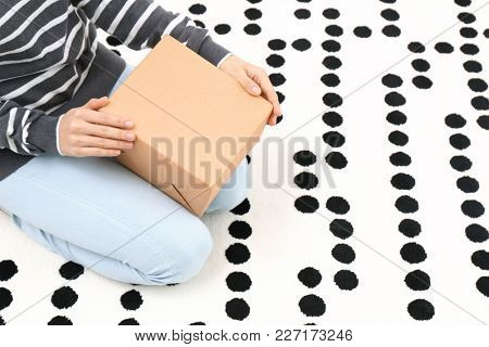 Woman with parcel box indoors