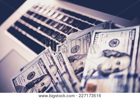 Internet Scam Money. Earned Dollars From Cyber Crime Conceptual Photo With Banknotes Laying On The L