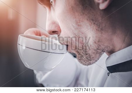 Caucasian Men In His 30s With Cup Of Fresh Cappuccino Coffee.
