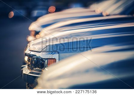New Vehicles In Dealer Stock. Shallow Depth Of Field Closeup Photo. Automotive Industry.