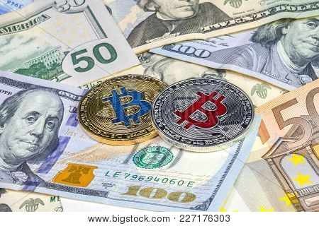Golden And Silver Bitcoin On Dollar And Euro Bills. Cryptocurrency Background