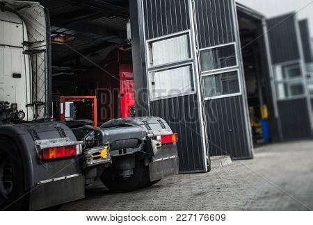 Servicing Semi Truck. Truck Tractor In The Service Gate. Transportation Industry Theme.
