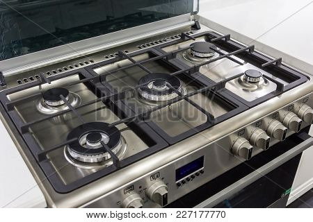 Closeup Of Brand New, Modern Gas Stove On Countertop In Contemporary Modern Home Kitchen.