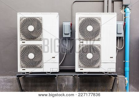 Many External Air Compressors Units Installed Outside Of The Building