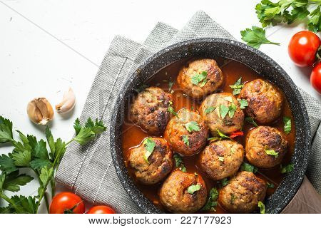Meat Balls In Tomato Sauce In A Frying Pan. Top View On White Background.