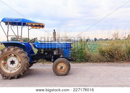 E-taen Vehicle Or Farm Tractor In Countryside With Green Organic Vegetable Farm Scenery, Agricultura