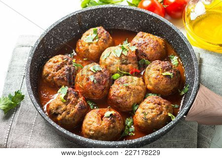 Meat Balls In Tomato Sauce In A Frying Pan. Close Up.