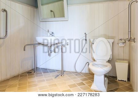 Interior Of Bathroom For The Disabled Or Elderly People. Handrail For Disabled And Elderly People In