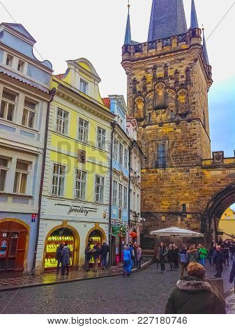 Prague, Czech Republic - December 31, 2017: The People Going Near Houses Of Old Architecture In Old