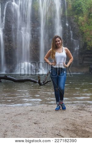 Beautiful Young Woman Posing In Front Of The Waterfall Llanos Del Cortez In Costa Rica