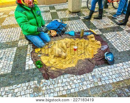 Prague, Czech Republic - December 30, 2017: A Street Artist Making A Sand Sculpture Of Dog At Prague