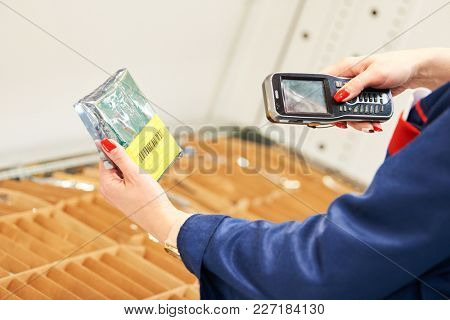barcode scanner usage. Female worker scanning the item