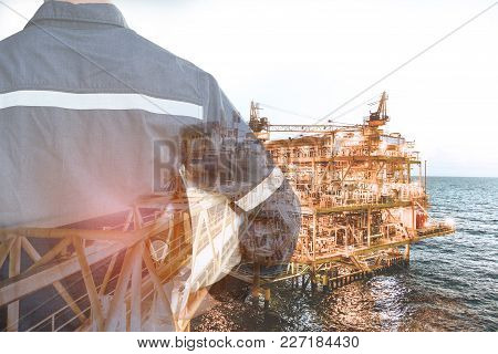 Double Exposure Of Engineer Or Technician Man Holding Safety Hat For Industry 4.0 Concept With Offsh