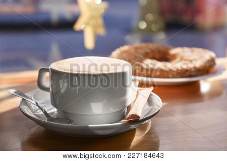 Cup of aromatic coffee for breakfast on table