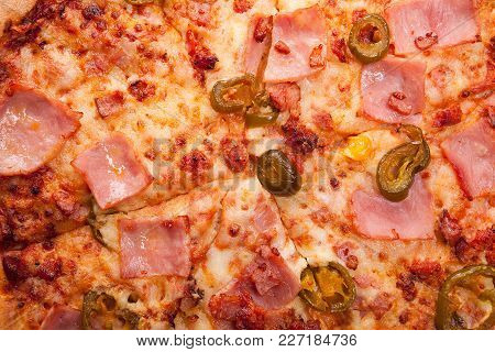 Close Up On Hot Fresh Pizza With Jalapeno