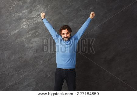 Excited Bearded Man Very Glad To Success. Happy Guy Smiling At Camera And Gesturing With Hands, Gray