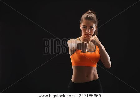 Athletic Woman Make Punch. Beautiful Fitness Model Showing Her Strength. Strong Hands, Shoulder Musc