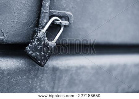 A Lock With Ice And Snow Outside