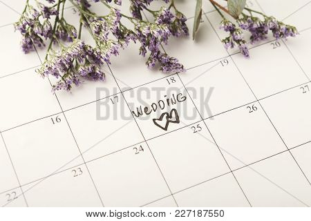 Word Wedding And Two Hearts On Calendar With Sweet Violet Flowers. Love, Invitation, Advertisement,