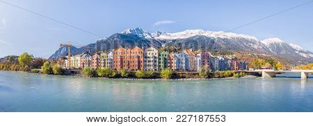 Panoramic View Of The Historic City Center Of Innsbruck With Colorful Houses Along Inn River And Fam
