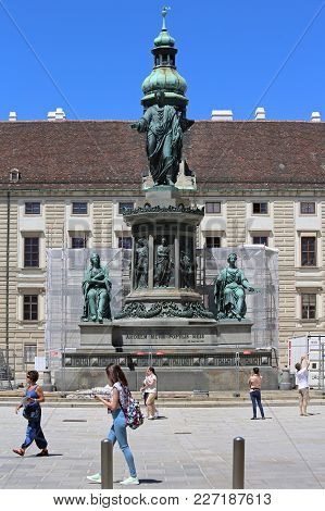 Vienna, Austria - July 11, 2015: Tourists In Front Of Kaiser Franz I Memorial At Hofburg Royal Palac