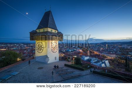 Panoramic Aerial View Of The Old Town Of Graz With Famous Grazer Uhrturm (clock Tower) Illuminated I