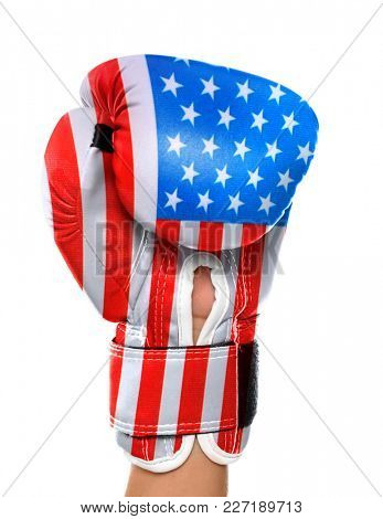Man wearing boxing glove colored in USA flag on white background. Concept of national power and strength