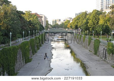 Vienna, Austria - July 11, 2015: People Walking Along Wien River At Stadtpark In Vienna, Austria.