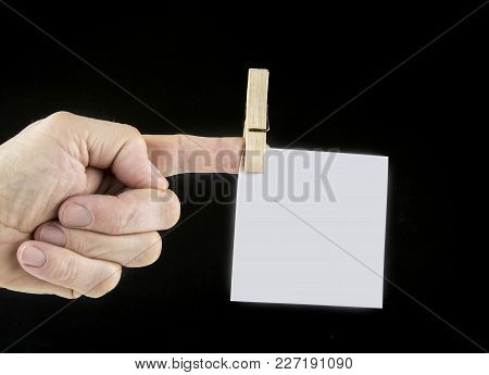Paper Note On The Finger Fixed With Clothes Pin