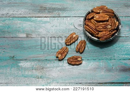 Tasty Pecan  In  Bowl On The Old Background.