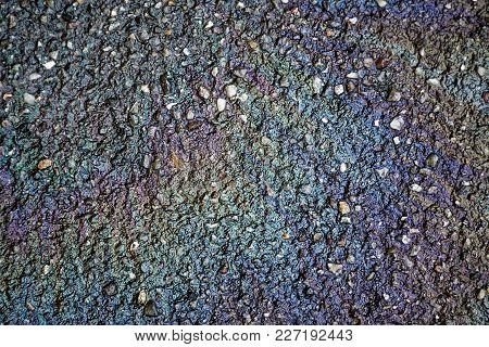 Oil Spill On Asphalt Road, Abstract Background Or Texture Foe Web Site Or Mobile Devices.