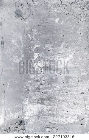 Gray Dirty Concrete Wall With Cracks And Spots. Background With An Unusual Texture.