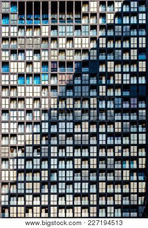 Closeup To Detail Of Highrise Residential Condominium Building Presenting Glass Windows Repatitive P
