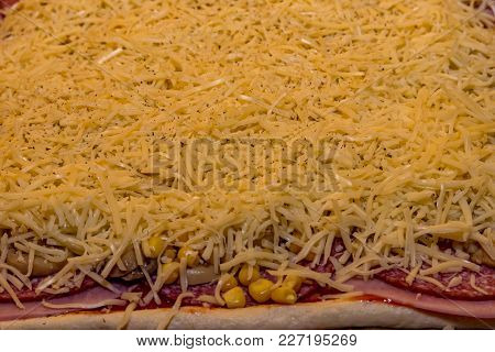 A Salami Ham Pizza With A Lot Of Cheese
