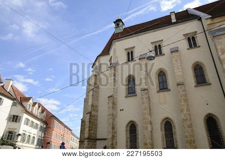 Lateral View Of The Church Cathedral Dedicated To Saint Giles In Graz,  The Capital Of Federal State