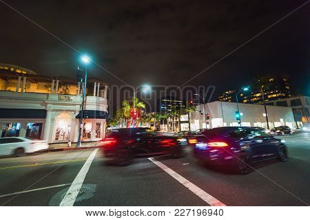 Traffic On Rodeo Drive At Night. Beverly Hills, California